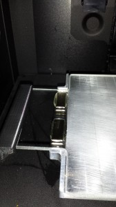 Magnet holding the plate in place